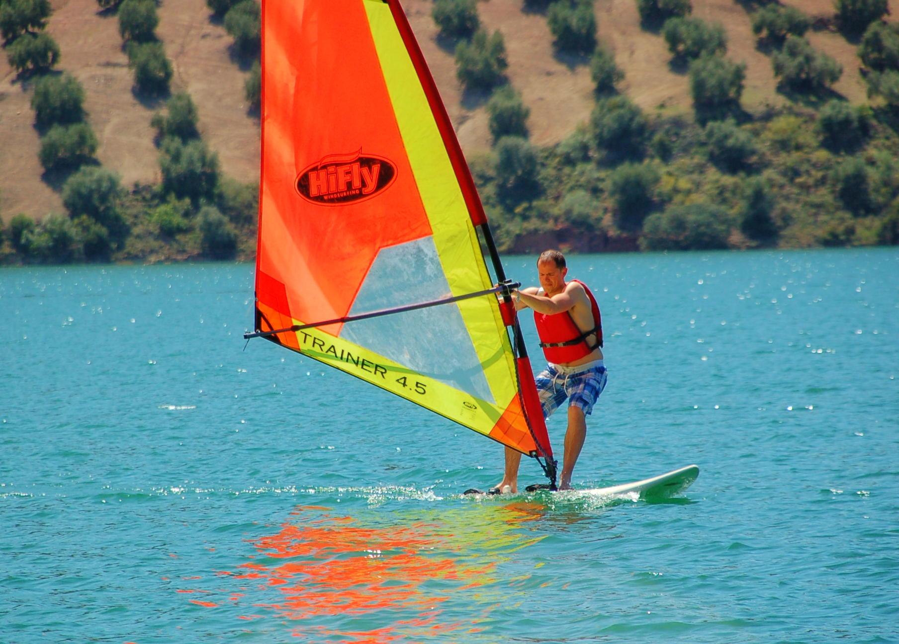 Winsurf Beach playa Iznajar Andalucia Swim sail Kayaks pedalos